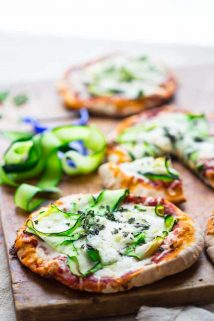 These 20 minute Zucchini Ribbon Pita Pizzas are a super fast, vegetarian weeknight meal that is also kid friendly. They will be making a regular rotation throughout zucchini season! | Healthy Seasonal Recipes | Katie Webster