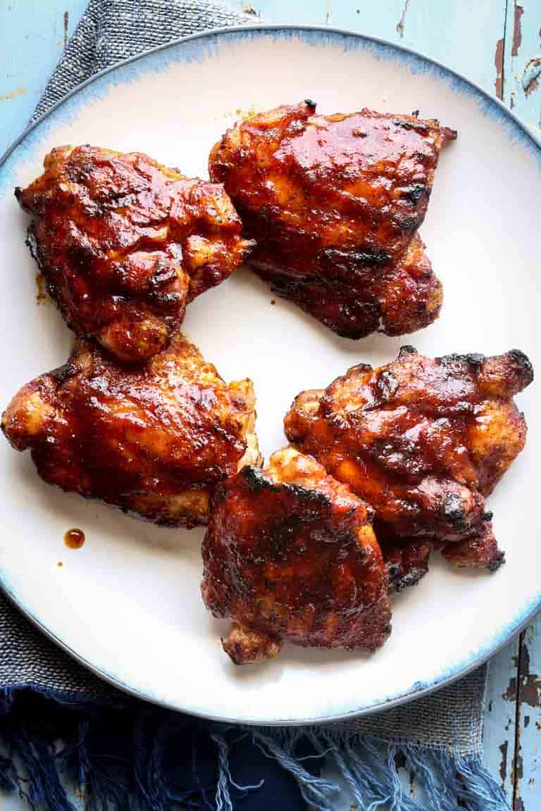 Simple Maple Chipotle Barbecue Chicken… These simple grilled chicken thighs with refined-sugar-free maple chipotle barbecue sauce are summer grilling perfection. The sweet, tangy, tender, juicy and smoky results are smokin' good, naturally gluten-free and paleo! | Healthy Seasonal Recipes | Katie Webster