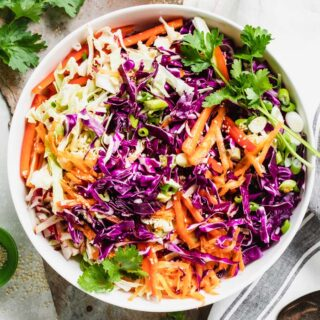 asian coleslaw in a bowl overhead closeup
