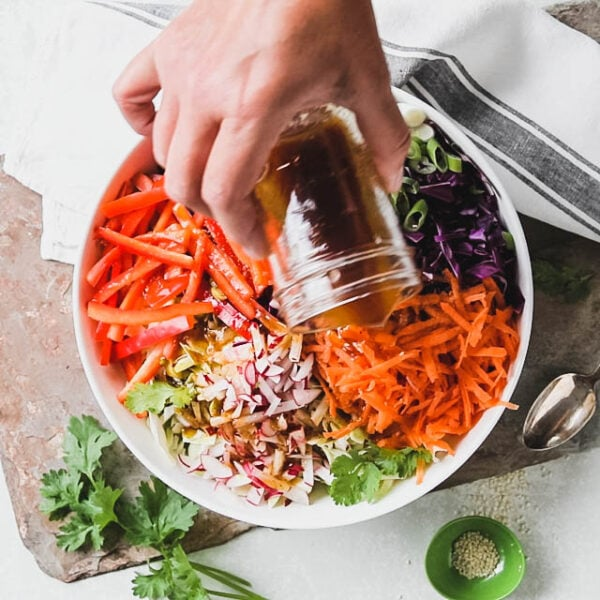 Pour the dressing over the coleslaw.