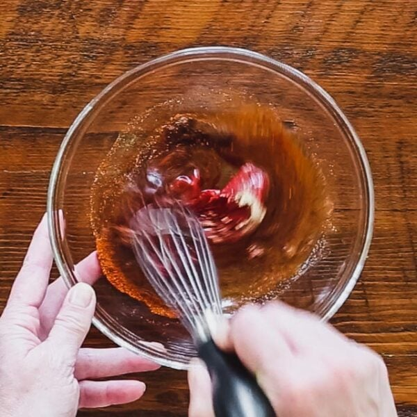 Whisk maple syrup, tomato paste, cider vinegar, chili powder, chipotle and garlic in a medium bowl.