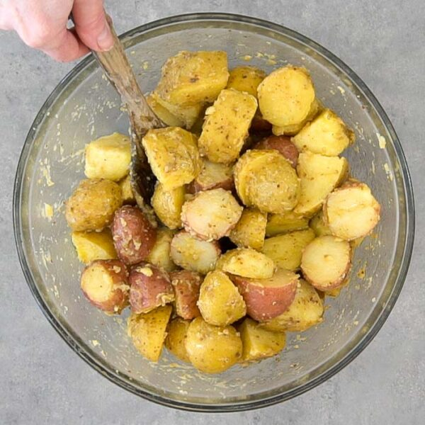 stir potatoes with the dressing