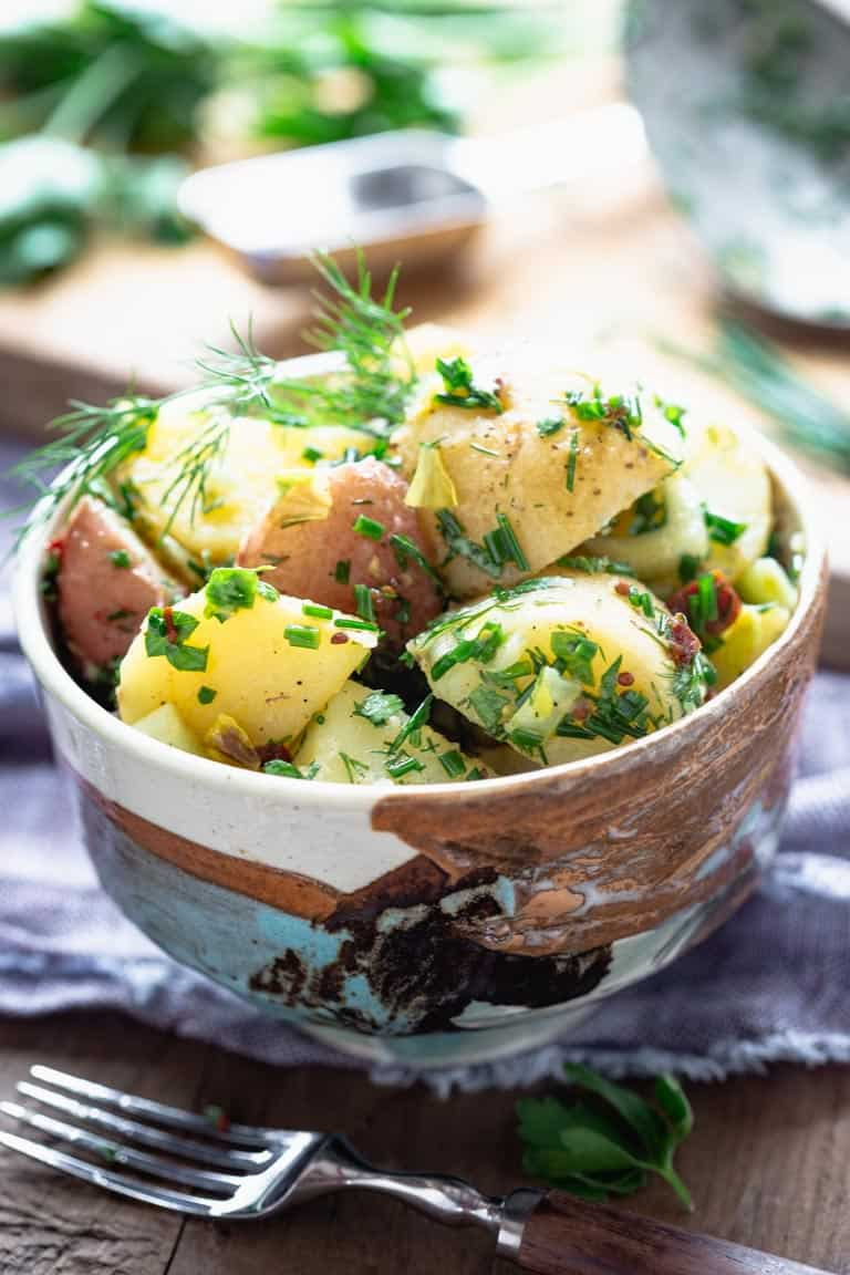 Vegan Potato Salad in a small hand painted ceramic bowl