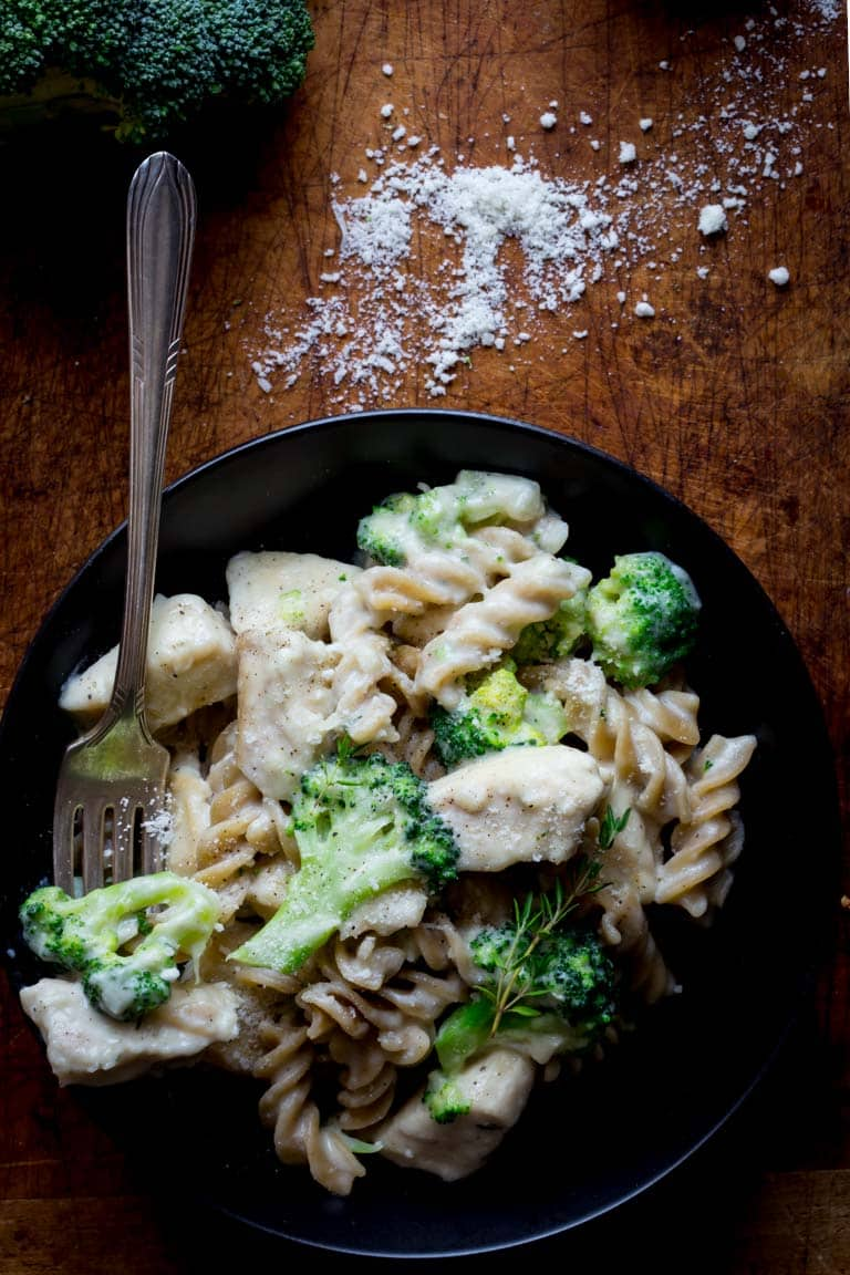 healthy chicken alfredo in a bowl with a fork