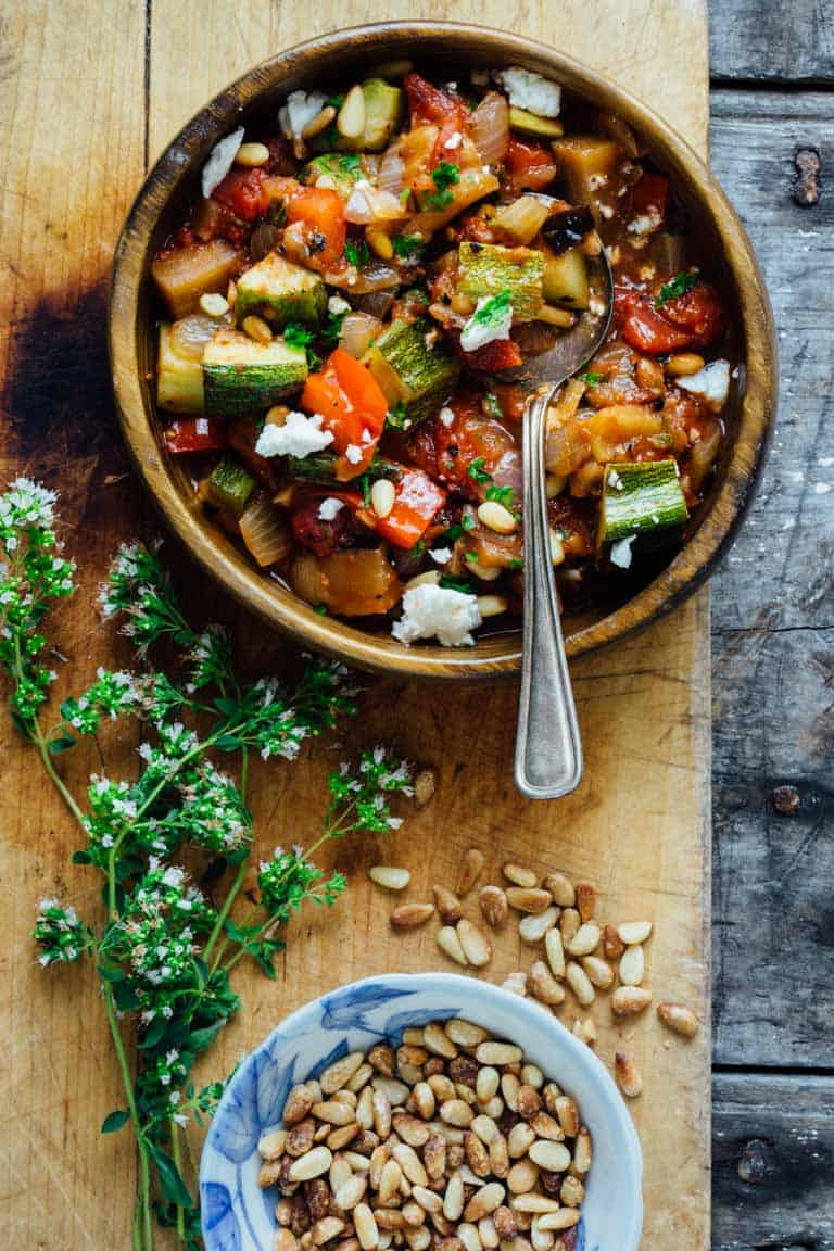 Smoky Ratatouille with Goat Cheese and Pine Nuts is an easy 25 minute recipe. This version is topped with fresh goat cheese and pine nuts and it's naturally grain-free and vegetarian. Just omit the goat cheese to make it vegan! | Healthy Seasonal Recipes | Katie Webster