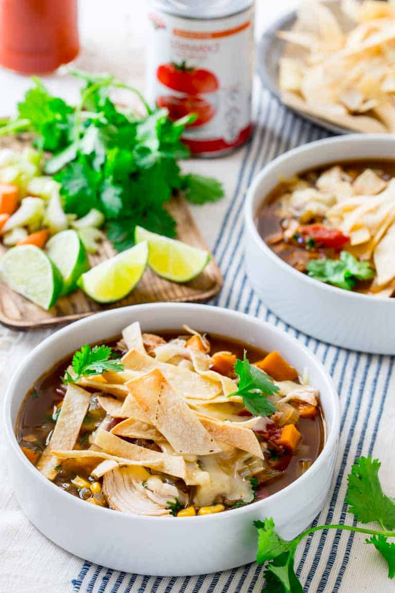 Slow cooker Chicken Tortilla Soup with tortilla strip and cilantro