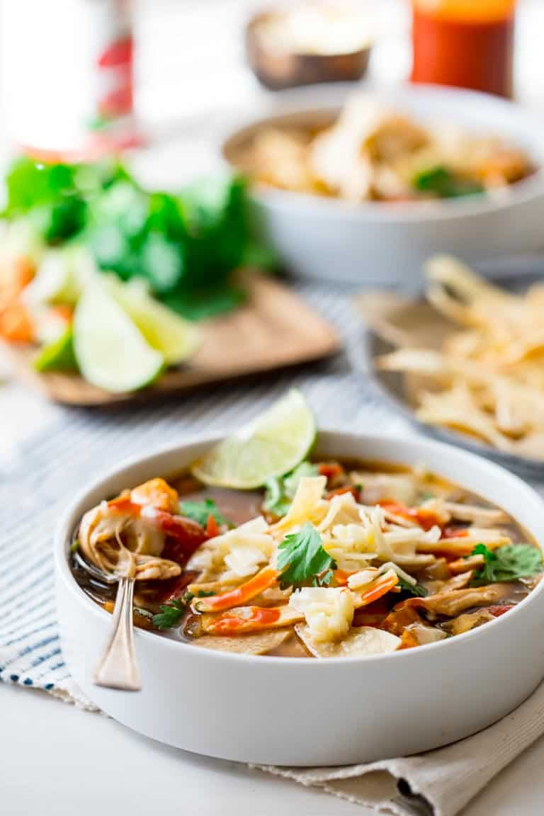 slow cooker chicken tortilla soup in white bowls