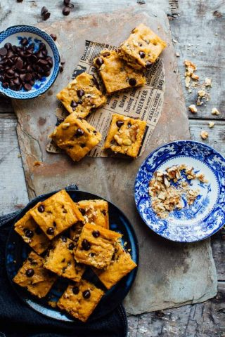 These Sweet Potato Blondies are chocked full of chocolate, toasted walnuts and are veggie packed, whole wheat and 100 calories less than the traditional version.Perfect for all of your Fall activities! | Healthy Seasonal Recipes