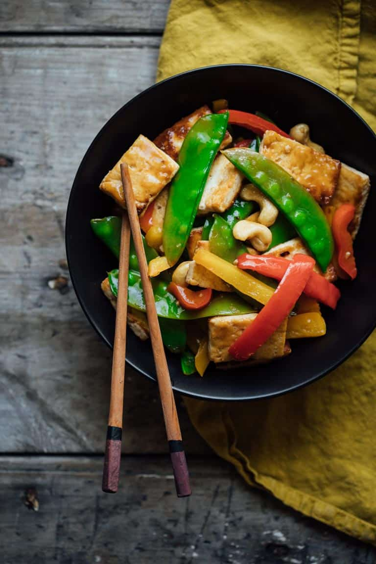 veggie stir fry in a bowl with chopsticks