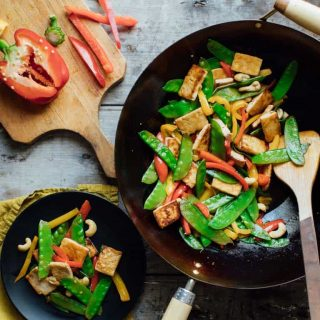 This Tofu Vegetable Stir-fry with Cashews meets all my requirements for an awesome weeknight dinner. It's quick, easy, veggie-packed and super kid-friendly. | Healthy Seasonal Recipes | Katie Webster