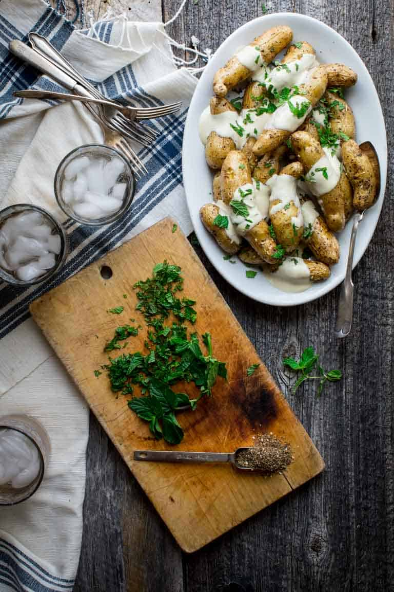 za'atar roasted fingerling potatoes with yogurt tahini sauce