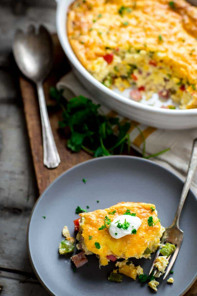 This easy and family friendly Baked Denver Omelet serves 8 and is ready in just 45 minutes! Bonus... it's great reheated and even makes an awesome lunch or dinner. | Healthy Seasonal Recipes | Katie Webster