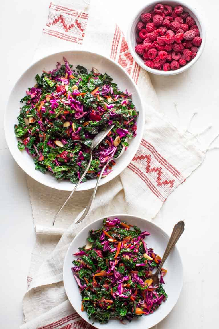 Festive Kale Slaw with Raspberries and Almonds, a festive gluten-free, vegan-friendly salad for Christmas or the holidays