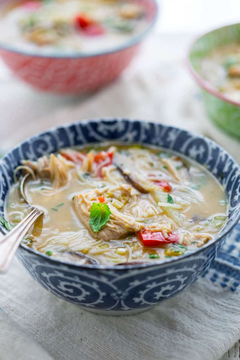 Slow Cooker Thai Chicken Coconut Soup with Rice Noodles and vegetables for a hearty easy weeknight meal on Healthy Seasonal Recipes #slowcooker #chickenrecipe #thai #glutenfree