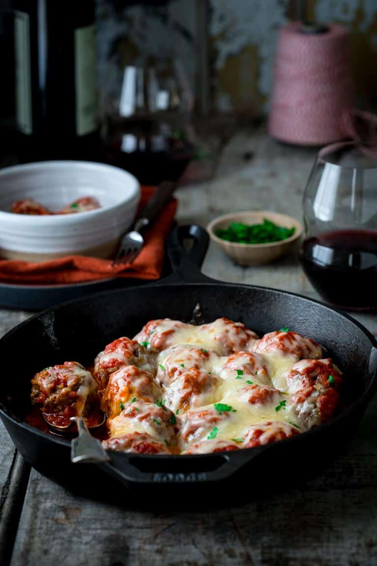 oven baked meatballs in a cast iron skillet