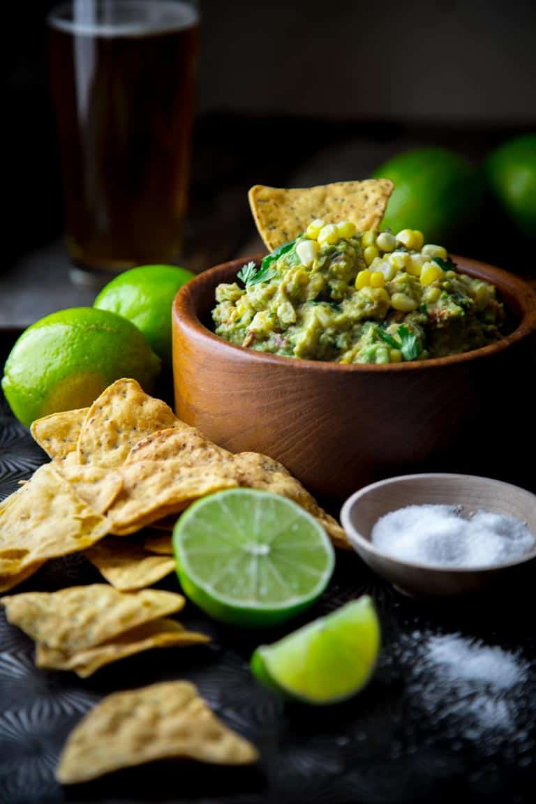 Corn and Bacon Guacamole with a touch of smoked paprika for added smokiness. Gluten-free appetizer for the superbowl or cinco de mayo. @healthyseasonal #glutenfree #appetizer #guacamole #party #superbowl #cincodemayo