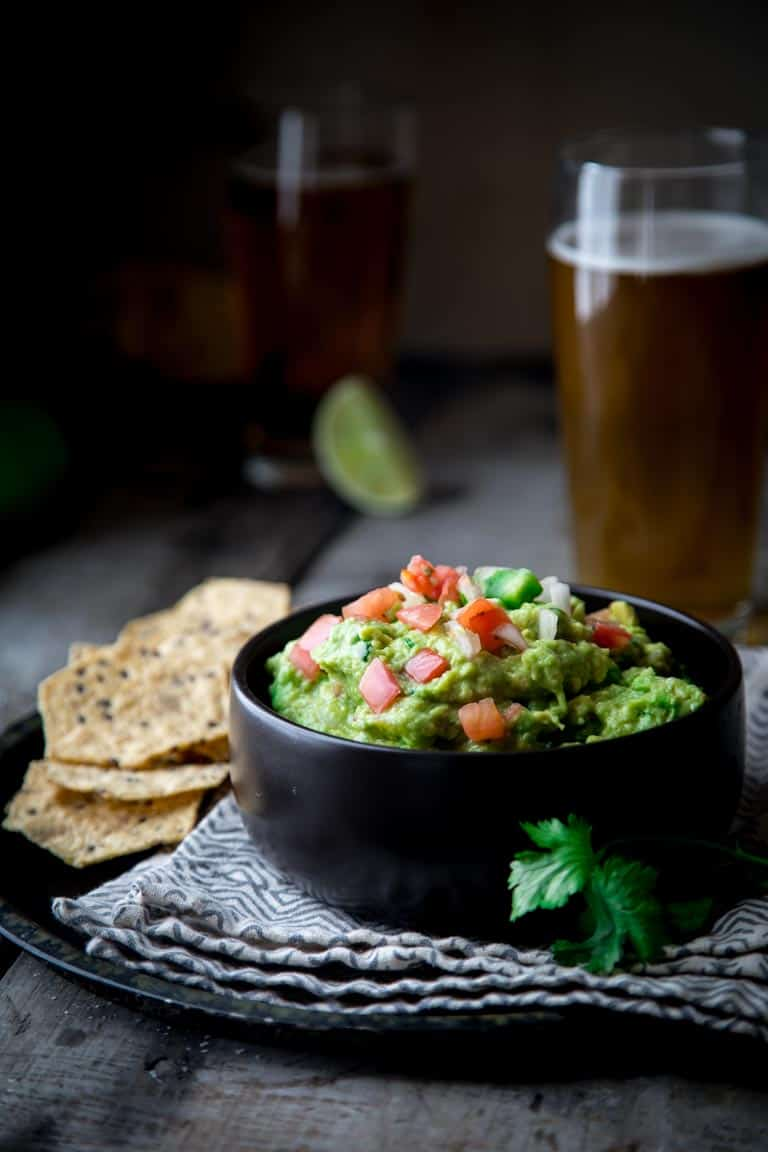 Chunky Pico De Gallo Guacamole on Healthy Seasonal Recipes. Learn how to make guacamole 5 ways for a festive and delicious twist on authentic guacamole for your next party! @healthyseasonal #glutenfree #vegan #guacamole #superbowl #cincodemayo #healthyrecipe