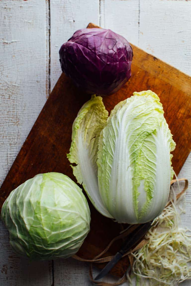 Napa Cabbage, green and red (or purple) cabbage on a cutting board