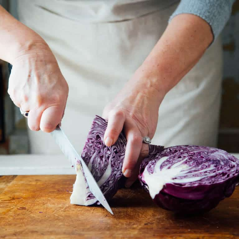 Remove the core from a head of cabbage