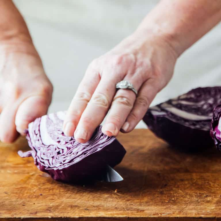 cut the cabbage into smaller wedges to make shredding easier | Healthy Seasonal Recipes