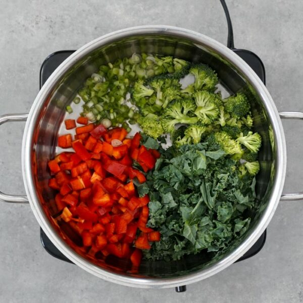 place veggies in a saucepan to steam them