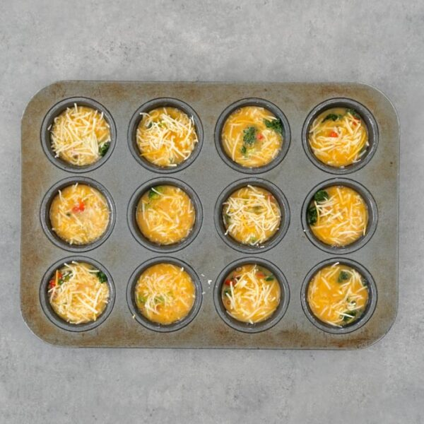 add egg to the muffin tins