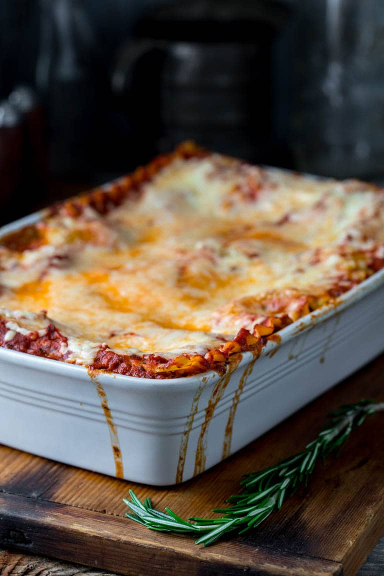Vegetarian Caramelized Onion and Portabella Mushroom Lasagna in a white baking dish