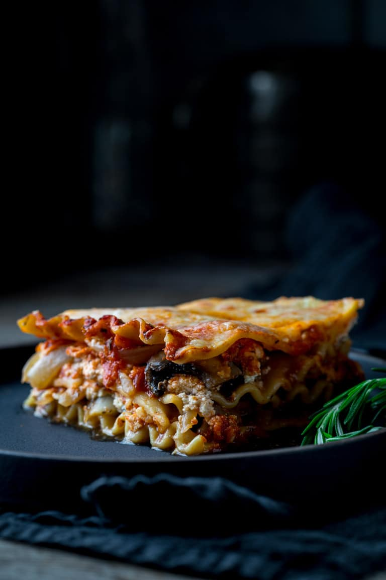slice on Vegetarian Caramelized Onion and Portabella Mushroom Lasagna on a plate