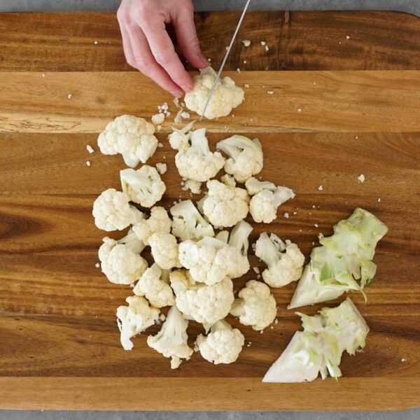 Cut the cauliflower into florets