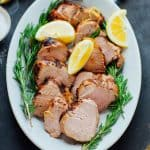 This Easy Grilled Lemon Garlic Pork Tenderloin recipe with rosemary is super simple, but full of flavor. It will be one you return to over and over again this spring and summer! It's naturally gluten-free, paleo, whole-30 and low carb. Healthy Seasonal Recipes by Katie Webster | #paleo #whole30 #lowcarb #glutenfree #spring #porktenderloin #rosemary #lemon #garlic