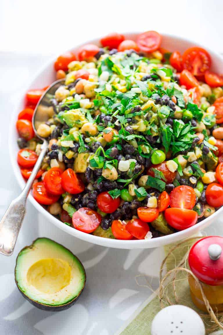 My new favorite summer side dish: Mexican Four Bean Salad. It's vegan and naturally gluten-free so everyone at the party will love it! #picnic #potluck #threebeansalad #mexicanfood