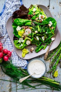 Roasted asparagus, chopped hazelnuts and fresh goat cheese bring staying power to these hearty spring entrée salads. They're naturally gluten-free and vegetarian. Healthy Seasonal Recipes by Katie Webster | #glutenfree #vegetarian #entreesalad #asparagus #goatcheese