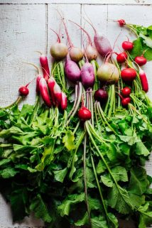The Ultimate Guide to Radishes, part of my Produce Spotlight Series on Healthy Seasonal Recipes. Your questions about if it okay to eat radishes on the keto diet. Can I cook radishes and can you eat radish greens. By Katie Webster. #radishes