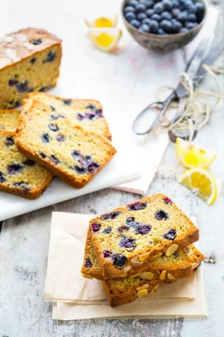 a table with several slices of blueberry lemon bread