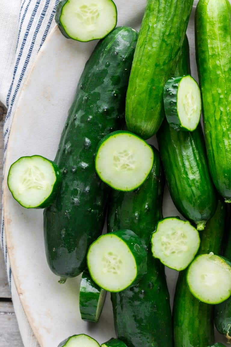 Have you ever wondered about why your cucumbers are bitter? Or whether or not you can freeze cucumbers? And what about how to grow cucumbers? Look no further than this Ultimate Guide to Cucumbers. These crunchy, refreshing veg is popular for good reason. See your questions answered below, along with cucumber recipes for inspiration.Healthy Seasonal Recipes by Katie Webster | #cucumber #summer #produce #fresh #gardening #cooking