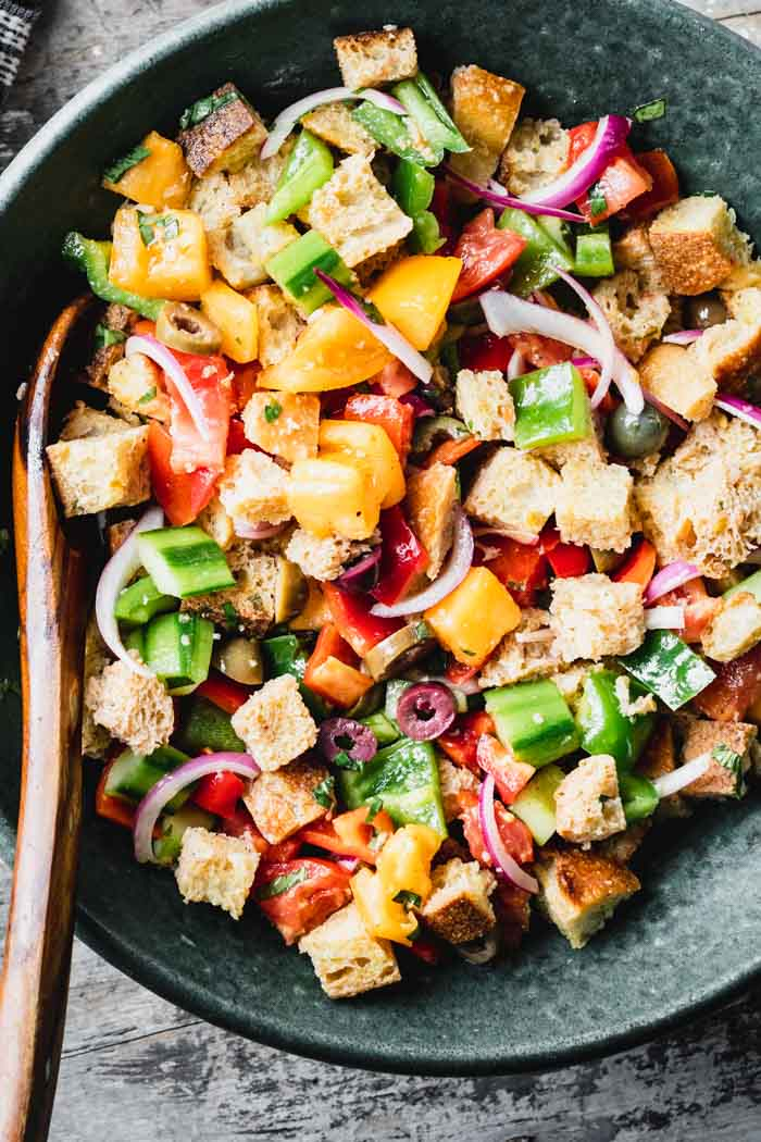 Overhead of a teal bowl filled with panzanella