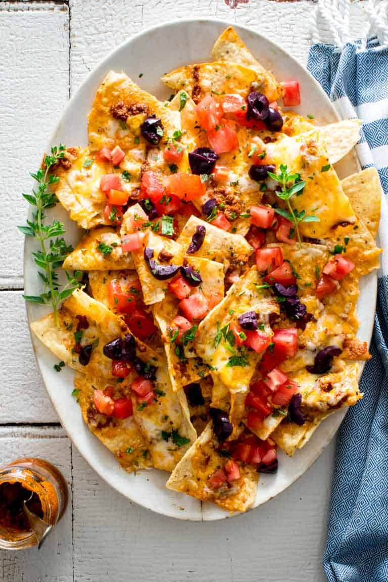 Tomatoes Two Ways Nachos with Sun-dried tomato pesto and fresh tomatoes! Healthy Seasonal Recipes by Katie Webster #appetizer