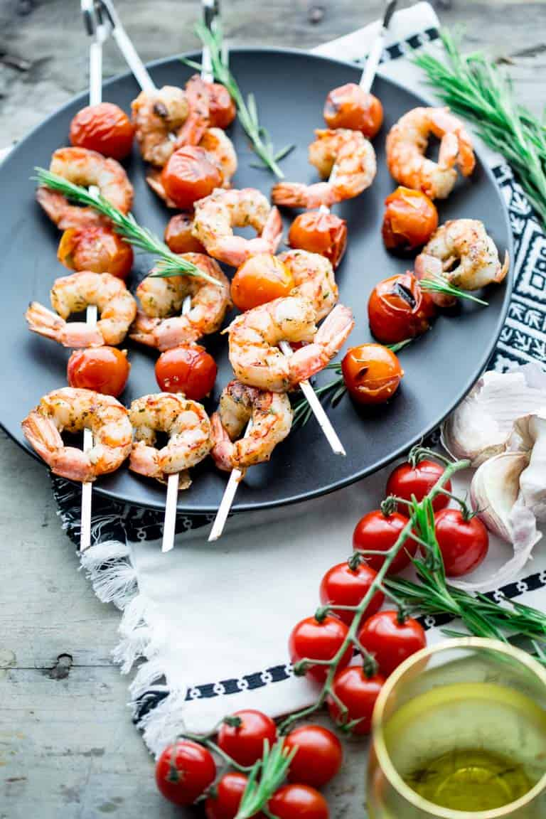 Nothing says summer like these rosemary shrimp and tomato kebabs. Fire up the grill this summer and enjoy these savory, buttery bites. Better yet, clean up is quick and easy! Great for weeknights with your family. Healthy Seasonal Recipes by Katie Webster | #summer #familyfriendly #kebab #savory #shrimp #tomato #quick #easy #lowcarb #keto