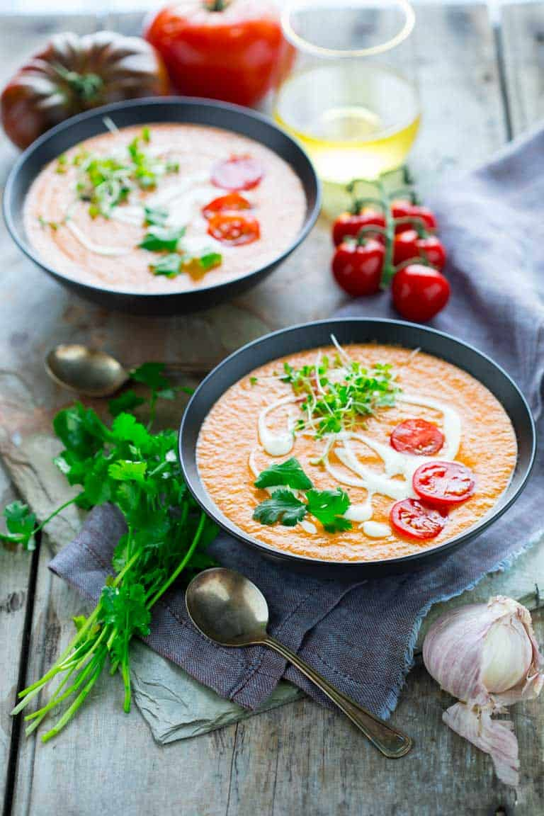10 Minute Gazpacho with tomatoes, peppers, cucumbers and fresh herbs- a delicious and easy chilled summer soup. Healthy Seasonal Recipes by Katie Webster #tomatoes #cucumbers #peppers #soup #gazpacho #gardening #vegetarian #veganfriendly #healthy