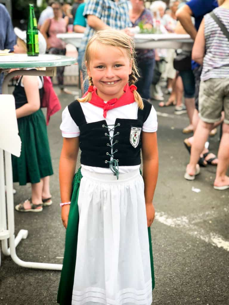 a little girl in traditional German clothing in the Mosel in Germany | healthyseasonalrecipes.com