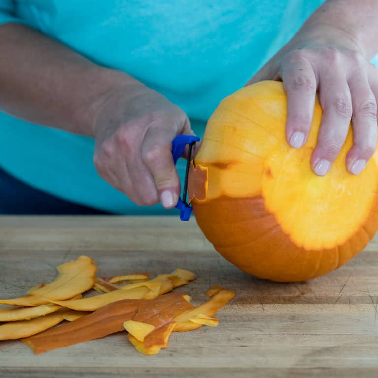 Peel a pie pumpkin with a sharp vegetable peeler
