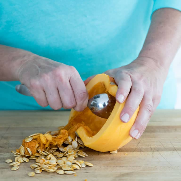 remove the seeds from the peeled fresh pie pumpkin