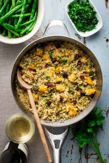 Please tell me you won't wait until Thanksgiving to try this Vegetarian Thanksgiving Pilaf with Pumpkin and Quinoa! It is too good to wait, and now that fresh pie pumpkins are in season, I highly recommend that you make it for dinner or serve it as a side dish. Seriously, don't wait. It's made with dried cranberries, leek and orange zest and it's naturally vegan and gluten-free so all the people will love it! #vegetarian #thanksgiving #pumpkin #quinoa #vegan #glutenfree #healthy #sidedish #onepot #stovetop #pilaf