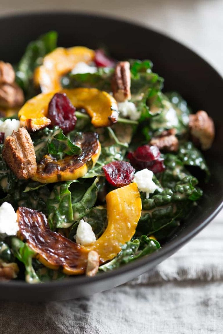 kale salad with delicata squash, cranberries, goat cheese and spiced pecans