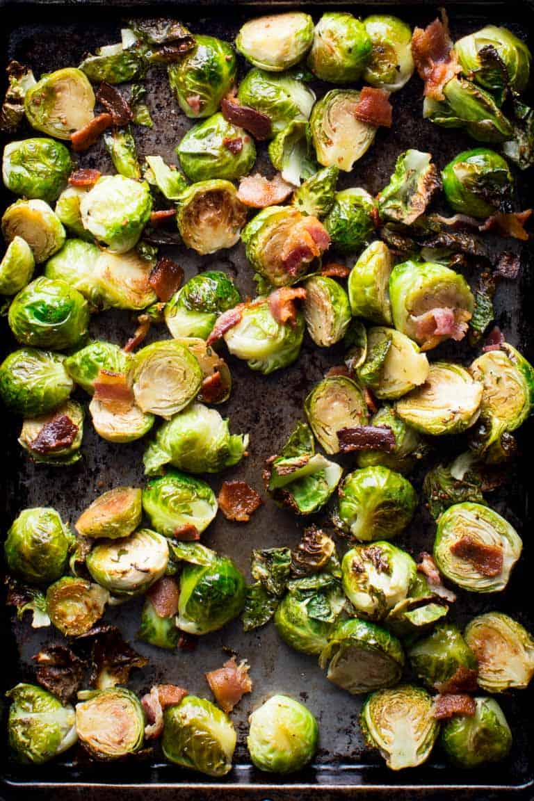 Maple Bacon Roasted Brussels Sprouts are an easy and delicious side-dish to try this fall. Healthy Seasonal Recipes | Katie Webster #brusselssprouts #sidedish #vegetables #bacon #maple #glutenfree #paleo #onepan #sheetpan