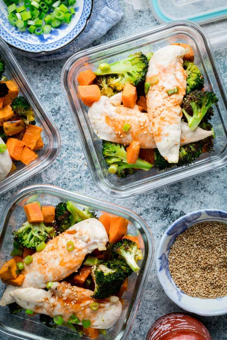 re-sealable glass containers with meal prep sheet pan chicken and broccoli
