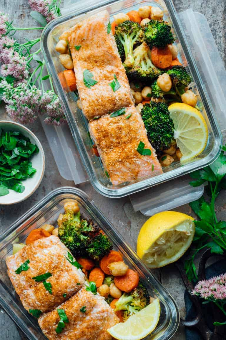 Sheet Pan Salmon Dinner with Moroccan Spice | Healthy Seasonal Recipes. A healthy one-pan meal prep dinner ready in only 40 minutes! The salmon is roasted with Broccoli, carrots and chickpeas with lemon, spice and parsley to add lots of fresh flavor. #sheetpan #mealprep #weeknight #easy #glutenfree #salmon #moroccan #onepan #broccoli #carrots