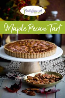 pecan tart on a table with nuts and leaves