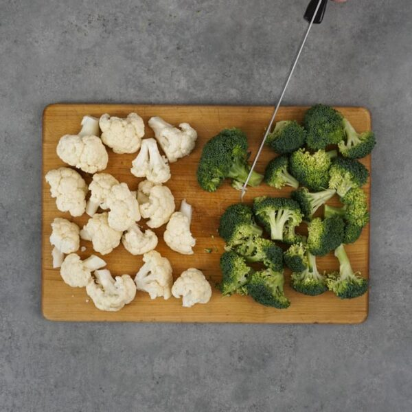Cut broccoli and cauliflower into florets