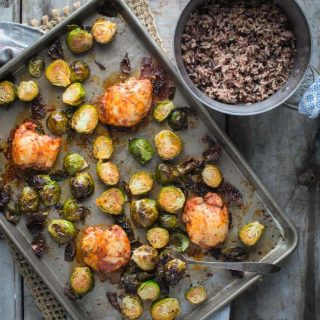Chicken and Brussels Sprouts Sheet Pan DInner on a sheet pan and also a pot of rice from overhead